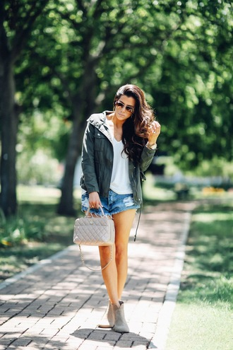 thesweetestthing blogger jacket t-shirt shorts shoes jewels bag sunglasses white top denim shorts nude bag green jacket distressed denim shorts blue shorts army green jacket white t-shirt boots grey boots aviator sunglasses casual