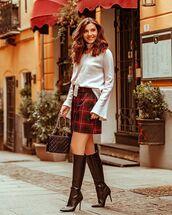 skirt,plaid skirt,knee high boots,heel boots,white sweater,black bag