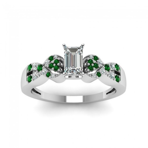 emerald cut engagement ring with emerald side stones