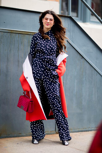 jumpsuit nyfw 2017 fashion week 2017 fashion week streetstyle polka dots blue jumpsuit shoes red coat coat bag pink bag chain bag sunglasses