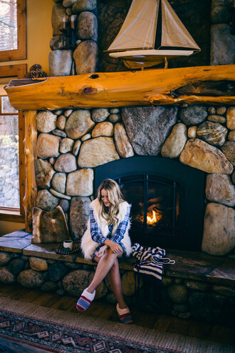 gal meets glam blogger faux fur vest white fur vest slippers fireplace home decor shirt dress tartan plaid