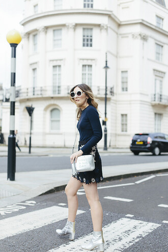 what olivia did... blogger silver bag metallic bag mini skirt floral skirt white sunglasses silver boots silver shoes metallic shoes sunglasses blue top long sleeves round sunglasses