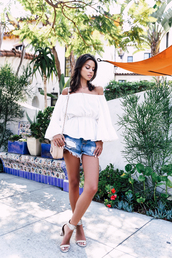 viva luxury,blogger,top,shorts,shoes,jewels,sunglasses,off the shoulder,long sleeves,denim shorts,shoulder bag,nude bag,silver heels,thick heel,bell sleeves,white top,off the shoulder top,distressed denim shorts,bag,chain bag,mid heel sandals,sandals,white sandals,block heels