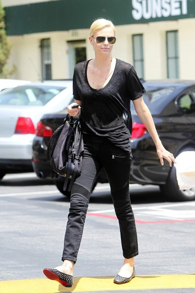charlize theron black jeans shoes
