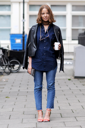 shirt fashion week street style fashion week 2016 fashion week london fashion week 2016 blue shirt black leather jacket leather jacket black jacket sandals sandal heels high heel sandals orange sandals clutch choker necklace necklace gold choker hairstyles streetstyle denim jeans blue jeans cropped jeans