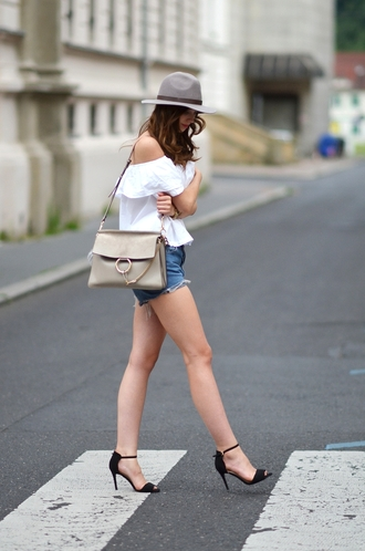 vogue haus blogger top shorts shoes bag hat jewels chloe faye bag chloe bag nude bag grey hat white top off the shoulder top denim shorts blue shorts sandals sandal heels high heel sandals black sandals