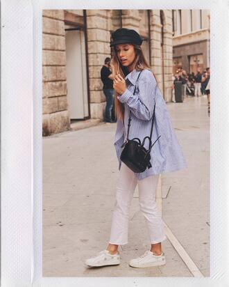 shirt blue shirt pants white pants handbag black handbag bag