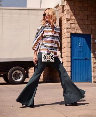top striped top pants black pants flare pants sunglasses bag