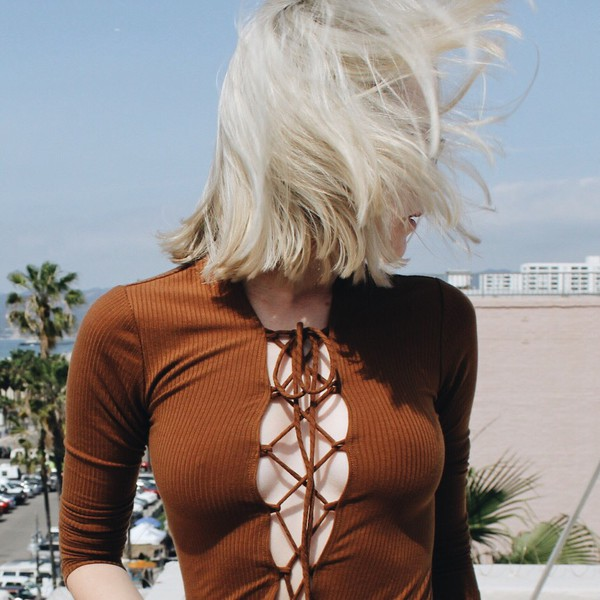 shirt lace up top fall colors blonde hair short hair top lace up plunge neckline