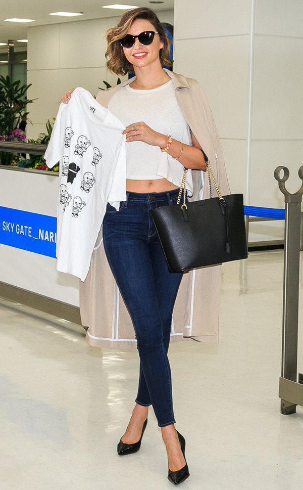crop tops jeans miranda kerr sunglasses pumps purse coat black bag skinny jeans cropped jeans black heels black stilettos nude jacket white top