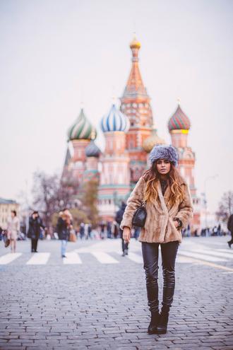 she wears fashion blogger hat leather pants faux fur jacket fur hat disney black leather pants fur coat camel coat black bag beige fur jacket