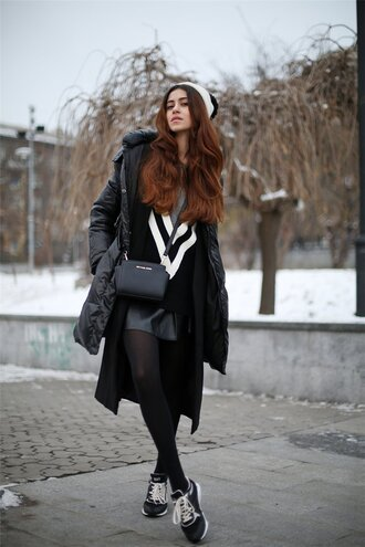 tina sizonova blogger bag down jacket pom pom beanie black and white winter outfits
