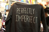 sweater,imperfection,shirt,quote on it,perfectly imperfect,black sweater,sweatshirt,perfect,cool shirts,hipster,boho,black,white,white letters,cute,tumblr,style,blouse,grey sweater,long sleeves