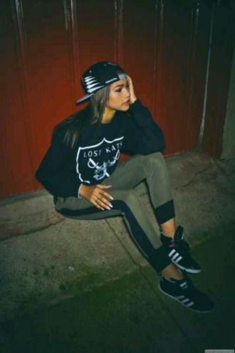 shoes black sneakers grey sweatpants hat zendaya adidas sneakers fashion black sweater snapback sweater joggers leggings cap trouser trainers adidas wings olive green shirt bag swag black pants