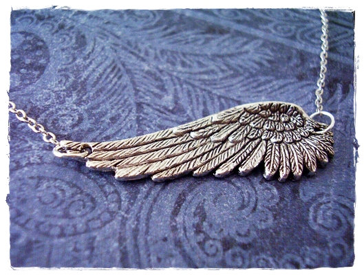 Antique pewter sideways angel wing charm on a delicate 18 inch silver plated cable chain