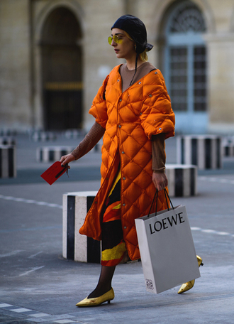 coat tumblr orange orange coat long coat quilted beige sweater skirt midi skirt printed skirt tights shoes pointed toe metallic metallic shoes mid heel pumps kitten heels hat sunglasses retro sunglasses fashion week 2017 streetstyle yellow sunglasses monochrome outfit
