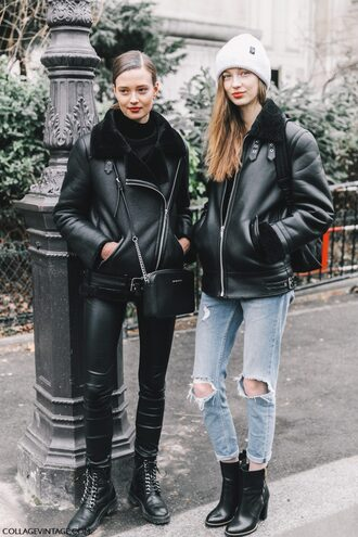 jacket tumblr fashion week 2017 streetstyle shearling jacket black shearling jacket shearling black jacket black leather jacket leather jacket androgynous jeans denim blue jeans ripped jeans destroyed denim boots black boots ankle boots high heels boots pants black pants black leather pants leather pants beanie equality