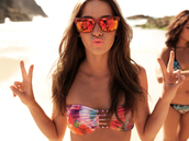 orange sunglasses,sunglasses,orange,red sunglasses,bikini,red swimwear,blue swimwear,purple swimwear,tie dye,nail polish,lipstick,peace,beach,brunette,swimwear,jessica lowndes,90210,90210 adriana,perfect