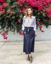 skirt,maxi skirt,jamie chung,blogger,sandals,blouse,shoes,button up skirt,midi skirt,office outfits,denim skirt,button up denim skirt,button up,lace up,lace up top,blue top,long sleeves,caged sandals,sandal heels,high heel sandals,black sandals,spring outfits