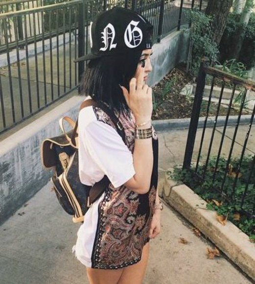 kylie jenner top backpack gold watch dark hair middle finger snapback snapback hat celebrity
