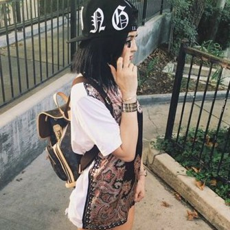 middle finger top celebrity style backpack gold watch dark hair kylie jenner snapback snapback hat the middle