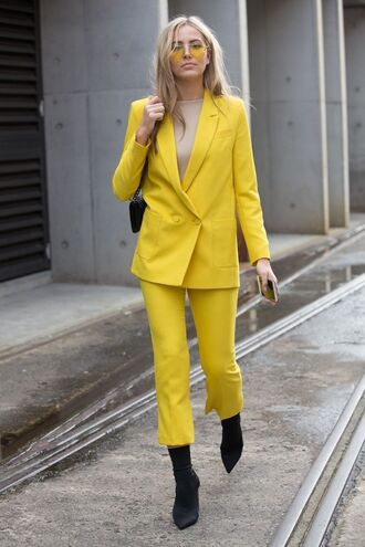 pants all yellow outfit yellow cropped pants boots sock boots pointed toe blazer matching set streetstyle power suit yellow pants