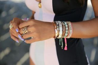 white swimwear jewels black top bracelets nail polish blue swimwear purple nails ring