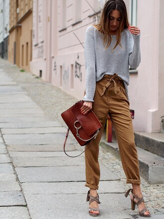 blogger jewels grey sweater boho pants red bag thick heel suede lace up heels
