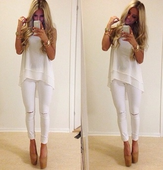 blouse jeans shoes jewels pants tank top spring summer white top sleevless sexy denim ripped jeans ripped denim white jeans white skinny jeans ripped skinny jeans celebrity style fashion white white blouse white tank top ripped