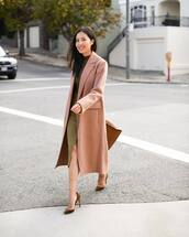 coat,long coat,wool coat,pumps,suede pumps,handbag,midi skirt,wrap skirt,black blouse