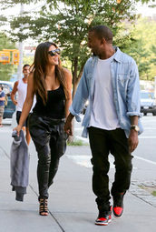 pants,kim kardashian,leather,baggy,black