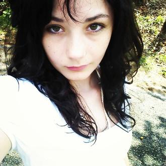 green eyes curly hair white shirt