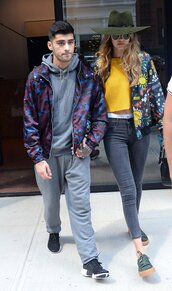 jacket,jeans,zyan malik,gigi hadid,model off-duty,sneakers,top,crop tops,hat,streetstyle,shoes,green sneakers,low top sneakers