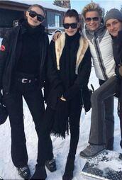 pants,snow,winter outfits,gigi hadid,bella hadid,belt,winter sports,gigi and bella hadid,black pants,black top,black sweater,white jacket,fur coat,winter sweater,winter jacket