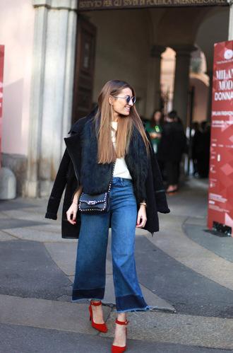 b a r t a b a c blogger flare pants red heels black coat faux fur vest coat sweater jeans shoes bag flare jeans