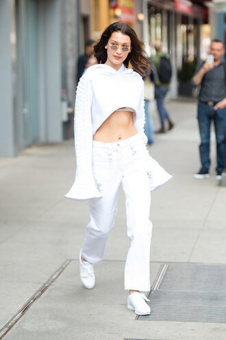 pants crop tops bra bralette bella hadid model off-duty streetstyle hoodie white white top sneakers sunglasses sweater underwear white hoodie white flared pants white sneakers blogger round sunglasses