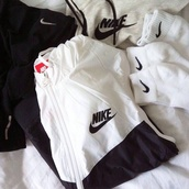 jacket,black and white,windbreaker,check,nike,zip up hoodie,hoodie,black and white nike,white,nike jacket,black,windrunner,sweater,socks,hoddie,nike windbreaker