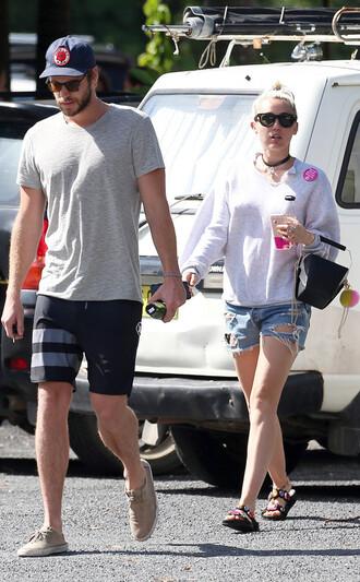 sweater sweatshirt miley cyrus shorts denim shorts sunglasses liam hemsworth bag