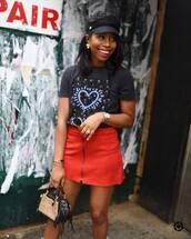 bag,handbag,mini bag,mini skirt,printed t-shirt,fisherman cap,earrings