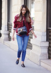 fadela mecheri,blogger,jacket,jeans,shoes,bag,jewels,baseball jacket,bomber jacket,red jacket,crossbody bag,black bag,blue jeans,gucci loafers,gucci,glasses,gucci shoes,black flats,black shoes,black loafers,french girl style