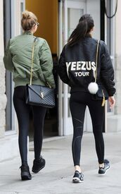 black jacket,kendall jenner,kanye west,yeezus,bomber jacket,fur keychain,bag charm,keeping up with the kardashians,gigi hadid,model,model off-duty,yves saint laurent,black leggings,nike shoes,bag accessories