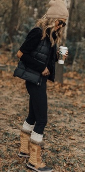 shirt,elbow patches,black top,hat,pom pom beanie,shoes,boots,faux fur,knitted socks,jeans,black jeans,skinny jeans,vest,sweater,black sweater,sunglasses,forest
