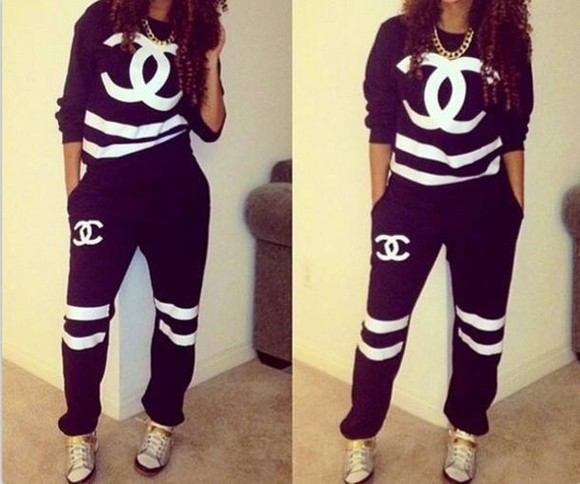 chanel black sweater sweatpants white stripes.
