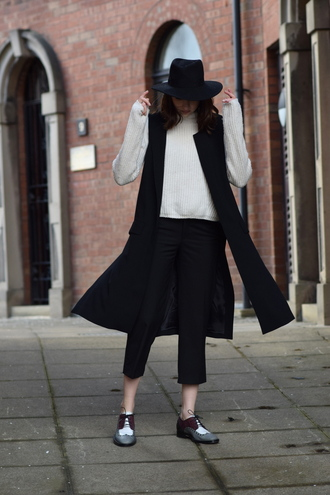 shot from the street blogger hat derbies vest black and white