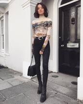 top,printed t-shirt,mesh,skinny jeans,black jeans,western belt,shoulder bag,black boots,earrings