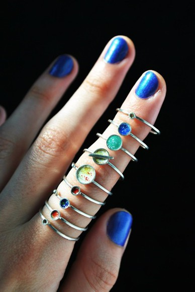 stacked jewelry sunglasses jewels ring knuckle ring silver planets planet rings and tings silver rings teal galaxy print solar system rings, blue colors planets rings ring color space planets small rings ring space world rings cute summer grunge jewls knuckle ring rings, jewels knuckle ring jacket accessories accessory nail accessories nail art nail polish jewels