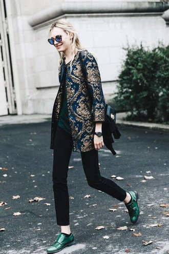 shoes coat paris fashion week streetstyle outfit blue green black gold monk leather bag pattern royal monks love printed coat fall coat black jeans jeans top green top sunglasses tortoise shell tortoise shell sunglasses black bag green shoes fall outfits