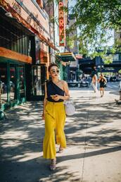 not jess fashion,blogger,top,pants,bag,one shoulder,yellow pants,summer outfits,sandals