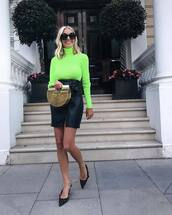 sweater,turtleneck,neon,jumper,leather skirt,front slit skirt,pumps,handbag,sunglasses,earrings