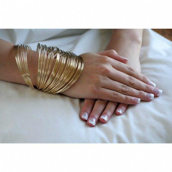 Rihanna gold multi bangle set